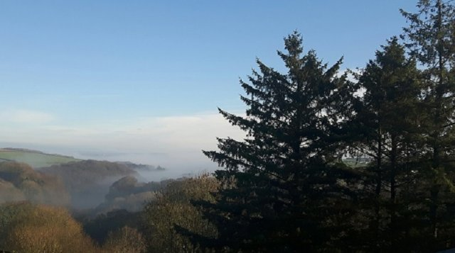 Misty December morning over Jennetts Valley from Robin Hill Farm Cottages  North Devon